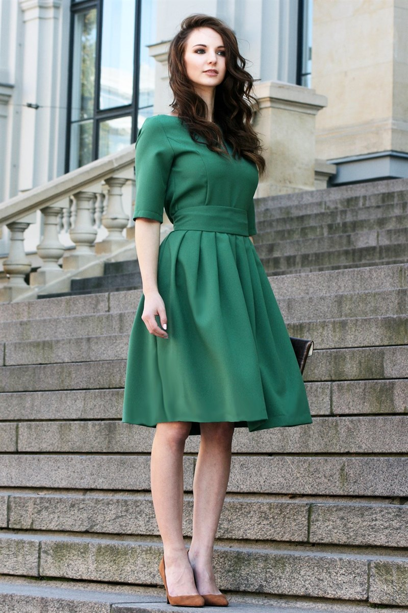 Dark green dress with pleated skirts