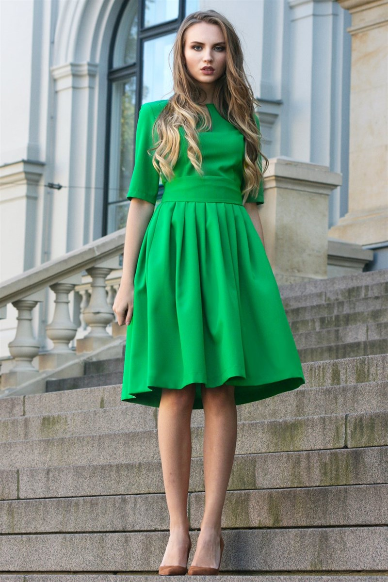 Green dress with pleated skirts